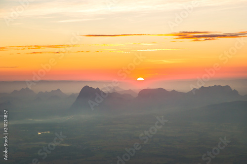 obraz lub plakat Sunrise landscape and golden light with pine trees on Phu Kradueng high mountains in Thailand.