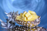 Pineapple fruit on a gray surrealistic background. Surrealism and alternate reality concepts.