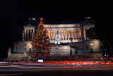 Christmas in Piazza Venezia. Rome, Italy - Piazza Venezia festively decorated, with the Christmas tree. In the background the monument to Vittorio Emanuele II, last king of Italy. Long exposure