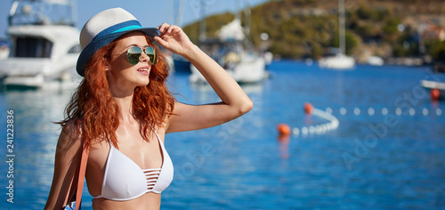 Leinwandbild Motiv Bikini girl on the beach. Young beautiful woman in bikini on the beach on Adriatic Sea