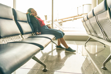 Asian girl waiting for flight at the airport