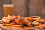 Chicken drumtick in on wood board - 241268820