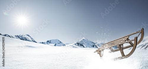 Leinwanddruck Bild Schlitten im Schnee