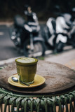 Matcha tea latte art with vegan coconut milk from above. Outdoor coffee shop table - 241295438