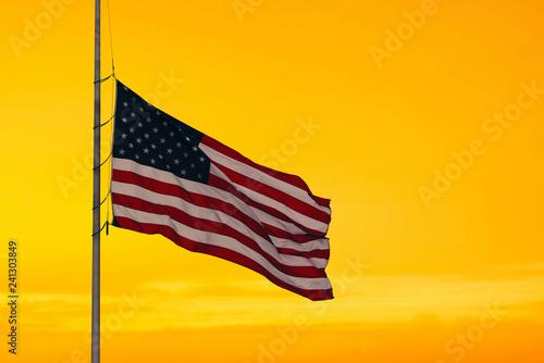 obraz lub plakat American flag on the sunset sky background