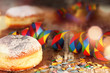 Leinwanddruck Bild - Donut with colorful carnival decoration