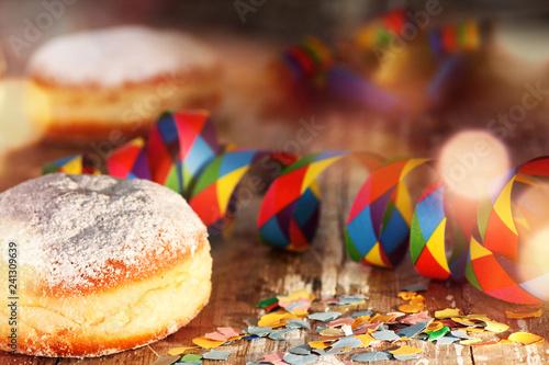 Leinwandbild Motiv Donut with colorful carnival decoration