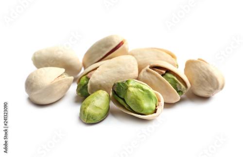 Leinwanddruck Bild Tasty organic pistachio nuts on white background, closeup