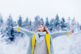 Beautiful girl in coat with cup of hot drink in a snow forest. Christmas of Valentine Day season time - 241338003