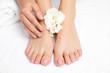 Leinwanddruck Bild - Woman touching her smooth feet on white towel, closeup. Spa treatment