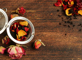Natural organic tea from dry roses on a wooden background - 241367011