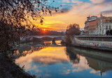Rome (Italy) - The Tiber river and the monumental Lungotevere at sunset.  - 241367873