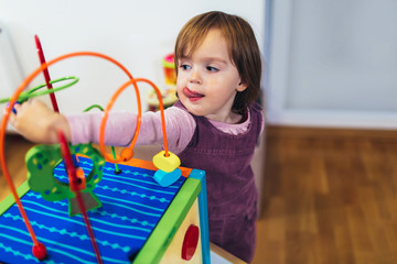 Cute child playing on table indoor