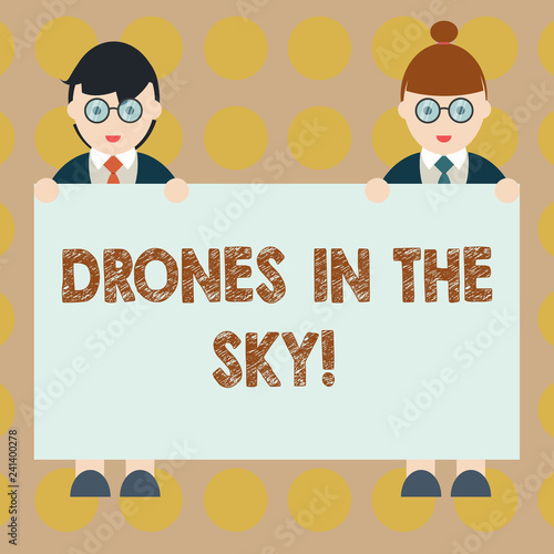 Word writing text Drones In The Sky. Business concept for Aerial helicopter modern device taking pictures and video Male and Female in Uniform Standing Holding Blank Placard Banner Text Space
