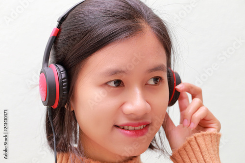 young woman listening to music - 241410471