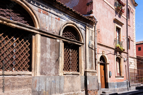 Travel to Italy -  historical street of Catania, Sicily, facade of ancient buildings. - 241415206