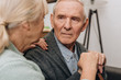 selective focus of sad pensioner looking at retired wife at home - 241427011