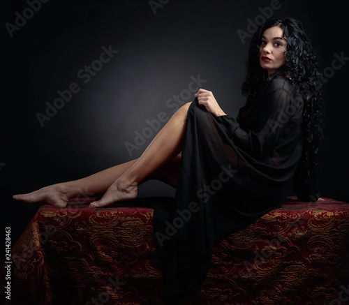 mata magnetyczna Young beautiful woman with long curly hair in lingerie.