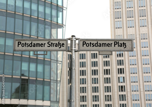big road signs with street name of Potsdamer Strasse and Platz t