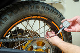 Control air pressure in motorcycle back tire