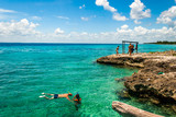 BAY OF PIGS, CUBA -SEPTEMBER 2015- Tourists practices snorkeling on the clear waters of Bay of Pigs, Cuba.