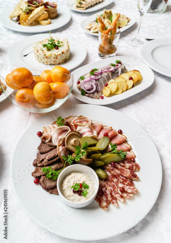 Christmas table with appetizers - 241469815