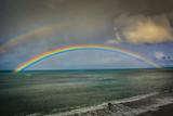 Fototapeta Tęcza - Hawaiian Rainbow over Kahana Beach in Maui, Hawaii © Art Boardman