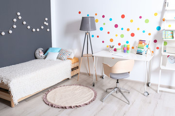 Modern child room interior with desk and bed