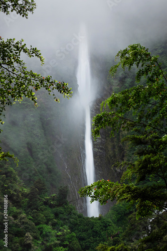 Large waterfall in New Zealand on cliff side - 241488856