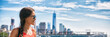 New York city woman tourist at One World Trade center skyline summer vacation USA travel lifestyle. Tourism in the USA. NYC banner panorama background.