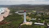 Aerial video of Split Point Lightouse along the Great Ocean Road - 241514043