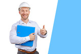 Happy young businessman architect smiling - 241515431