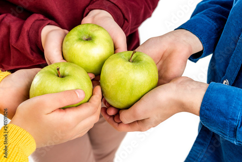 cropped view of kids holding green apples isolated on white