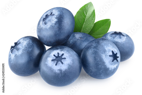 Foto Murales Ripe blueberries with green leaves, isolated on white background