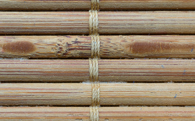 Small bamboo sticks tied together showing unique patterns and textures © Philip