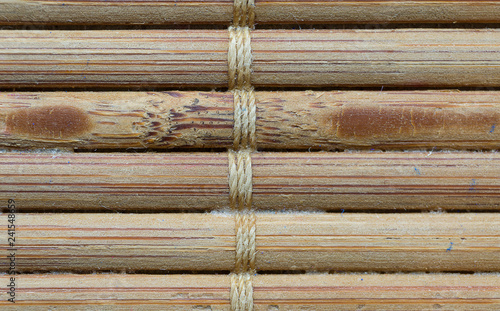 Small bamboo sticks tied together showing unique patterns and textures