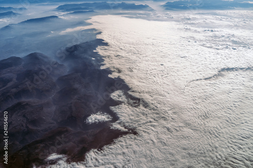 Landscape view of Alpine mountains with clouds from the plane - 241554670