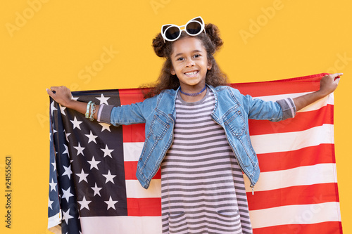 Delighted happy girl celebrating national American holidays
