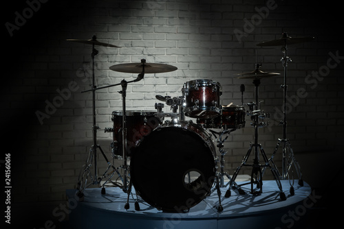 Drum set on a background of brick wall - 241560616