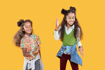 Positive afro american girls dancing to music