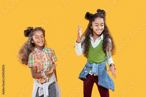 Positive afro american girls dancing to music - 241561836