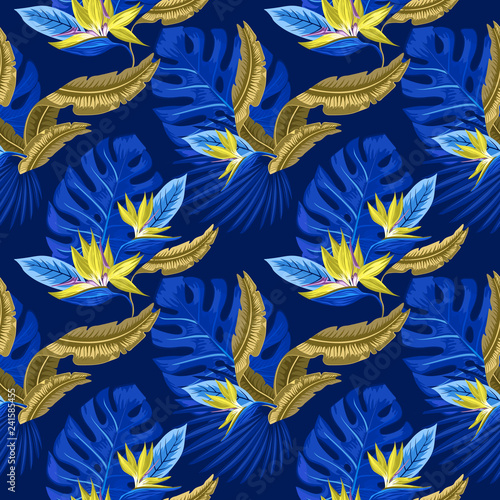 seamless pattern of tropical blue palm leaves, monstera leaves and coral flowers of the bird of paradise (Strelitzia) plumeria on a light blue background. Wallpaper trend design.