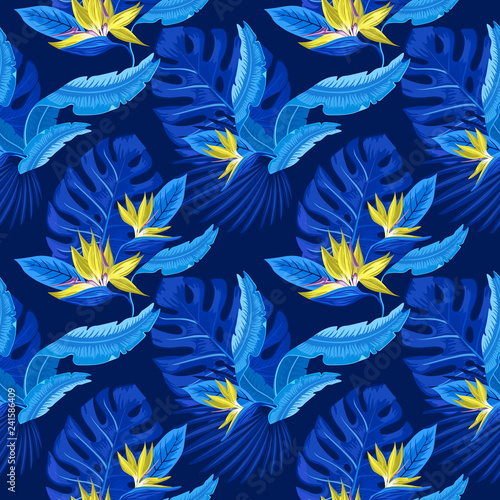 Vector seamless pattern of tropical blue palm leaves, monstera leaves and coral flowers of the bird of paradise (Strelitzia) plumeria on a light blue background. Wallpaper trend design.