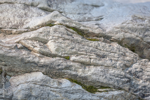 Image of stone texture. An interesting background with a fascinating texture, folded over hundreds of years. - 241592068