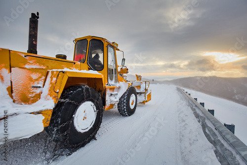 Snowblower at work in the mountains - 241592241