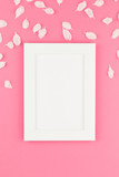 Flat lay of white frame mock up with petals - 241595829
