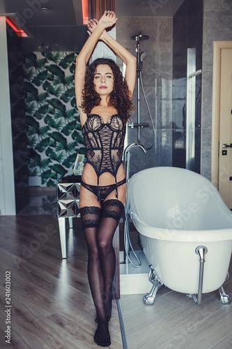 erotic woman posing in lingerie indoors - 241603002