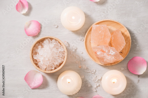Spa settings with roses. Spa theme with candles and flowers on table.
