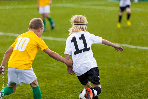 Leinwanddruck Bild Kids Play Soccer Game. Children Outdoor Football Tournament Match on Grass Field