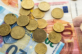 A pile of euro notes and coins - 241613879